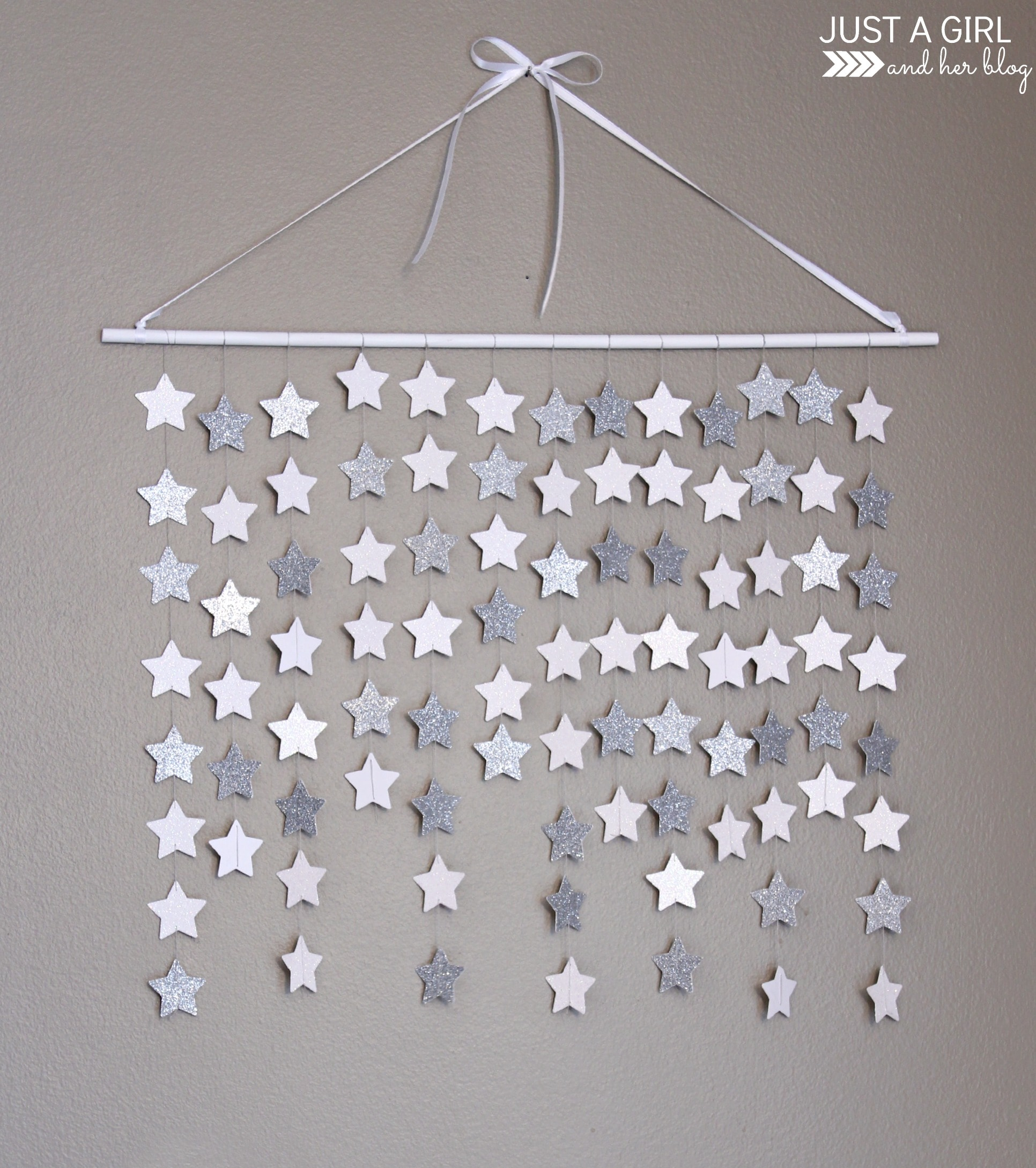 Falling star wall hanging just a girl and her blog for Hanging pictures on walls ideas