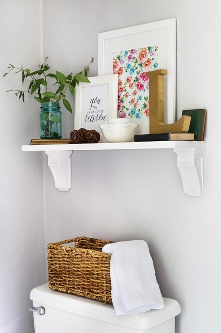 Learn how to make this inexpensive, beautiful shelf! Pop over to the post for the full tutorial!