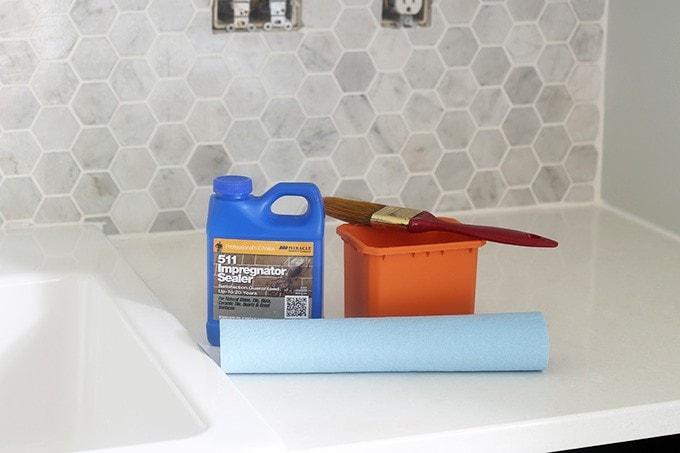 How to Install a Marble Hexagon Tile Backsplash | JustAGirlAndHerBlog.com