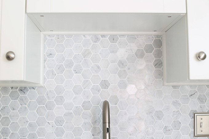 How to Install a Marble Hexagon Tile Backsplash | JustAGirlAndHerBlog.com