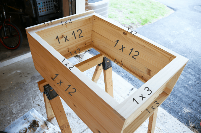 How to Make a Custom Tilt-out Trash Cabinet | JustAGirlAndHerBlog.com