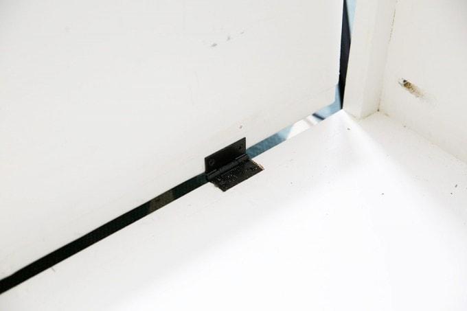 How to Make a Custom Tilt-out Trash Cabinet   JustAGirlAndHerBlog.com