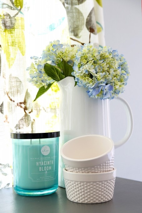 Hydrangeas in white pitcher. Beautiful white IKEA SEKTION GRIMSLOV kitchen with aqua and green accents, a gorgeous marble hexagon backsplash, and quartz countertops. | JustAGirlAndHerBlog.com
