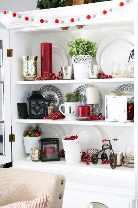 I've always wanted to style my dining room hutch for different holidays but wasn't sure how-- this post gives so many great ideas and makes it simple! My hutch is going to look beautiful for Christmas! Click through for so many awesome ideas! | JustAGirlAndHerBlog.com