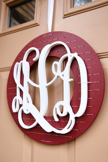 This easy and inexpensive monogrammed Christmas wreath would be perfect with our holiday decor! And it's so easy too! Click through for the full tutorial! | JustAGirlAndHerBlog.com