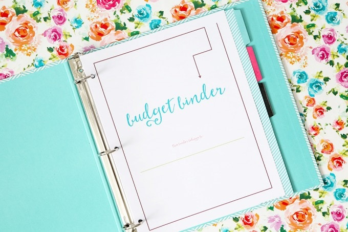 A beautiful, detailed free printable budget binder that will help you save more money and spend less in the coming year! Click through to snag your copy! | JustAGirlAndHerBlog.com