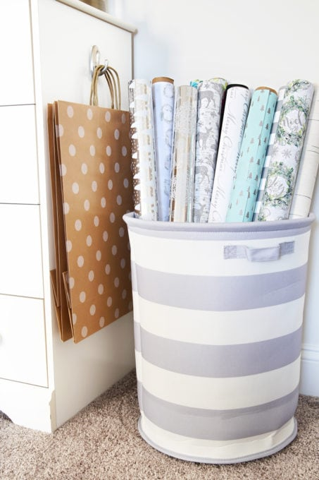 Organized Wrapping Paper in a Round Fabric Storage Bin