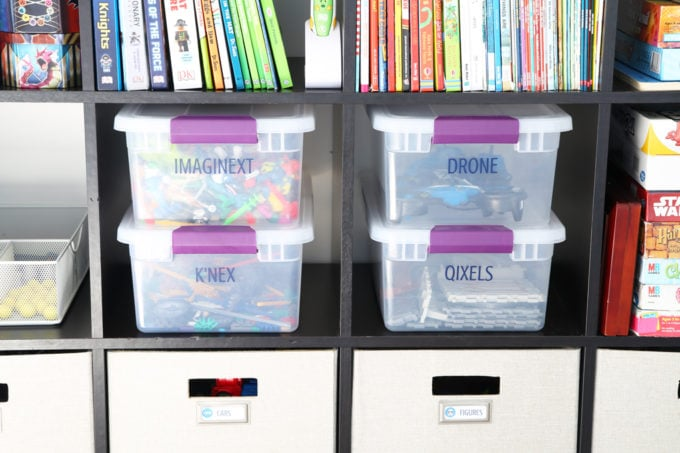Plastic Storage Tubs Used to Organize Kids' Toys in a Playroom