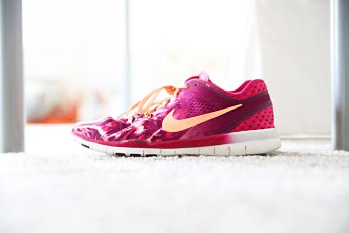 Pink and orange Nike running shoes