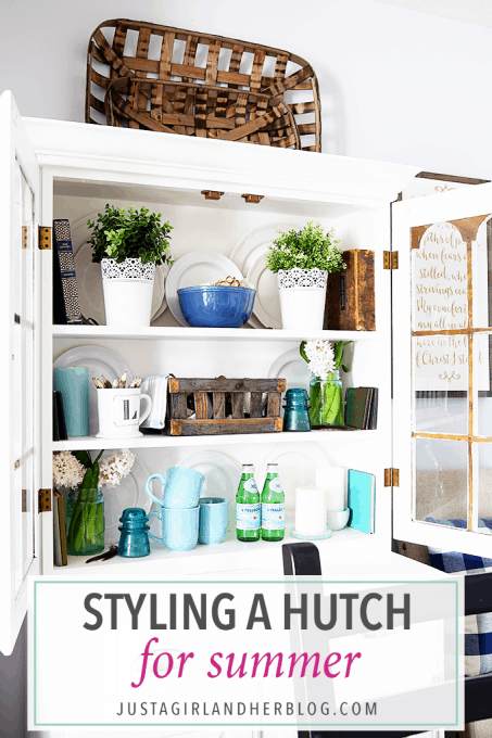 Love this beautifully styled hutch! All of the layers and natural elements just pop off of the white background!