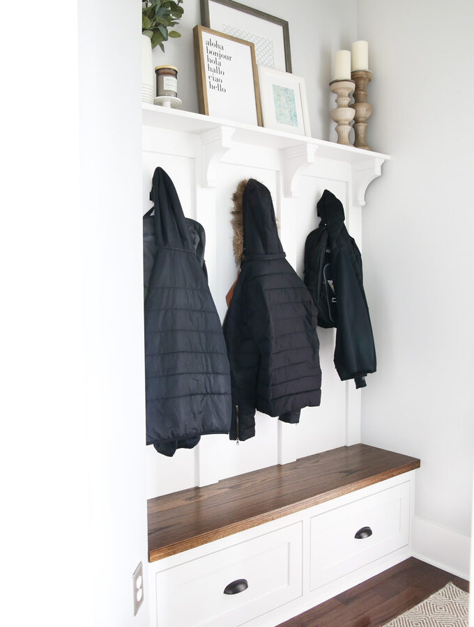 Mudroom with coats and backpacks hanging up