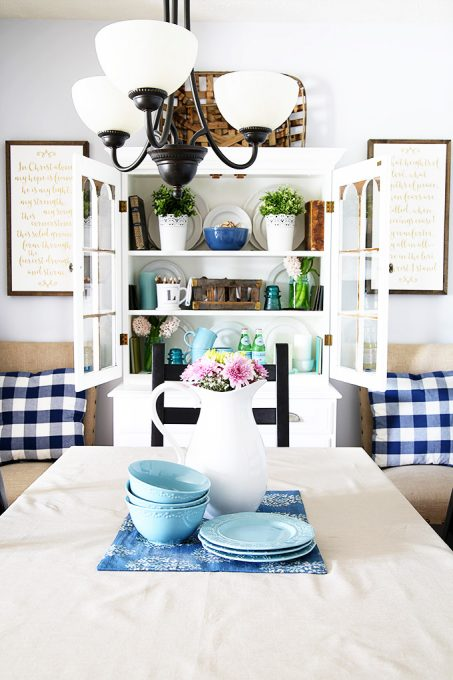Love this light and bright dining room with blue accents!