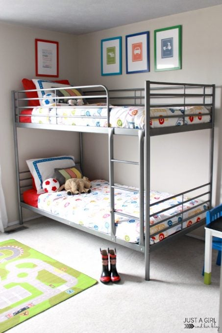 Love this adorable shared boy room! So bright and cheerful with a transportation theme!