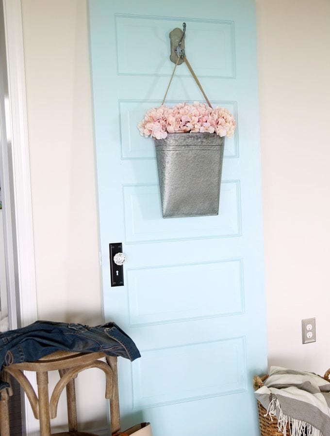DIY and Crafts- Door as Decor. Love the transformation of this painted door! It's amazing what a little bit of paint can do!