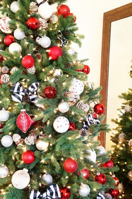 Holidays and Events: Popular Christmas Tree Decor. I love this beautiful, classic Christmas tree decorated with red, white, silver, and buffalo check! Click through to the post to see more!