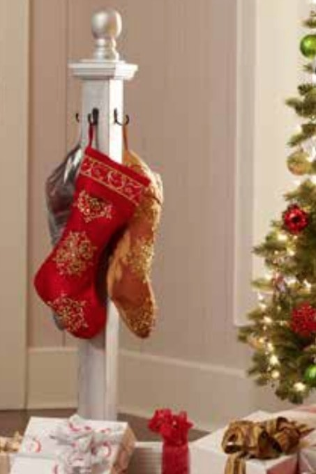 This DIY holiday stocking post is the perfect solution for hanging stockings when you don't have a mantel! Click through to the post for details!