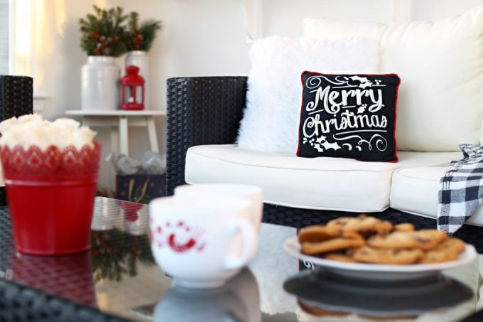 Love this beautiful sunroom all decorated for Christmas! Click through to the post for sources!