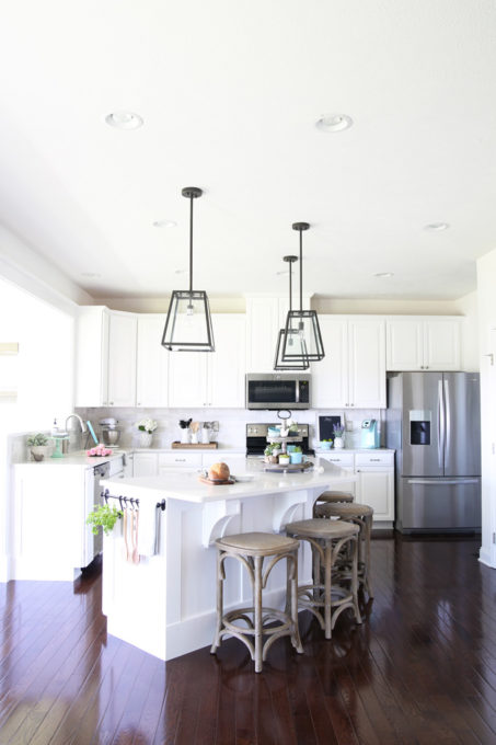 Home  A Gorgeous White Kitchen Makeover With Dark Hardwood Floors, Quartz  Countertops In Caesarstone