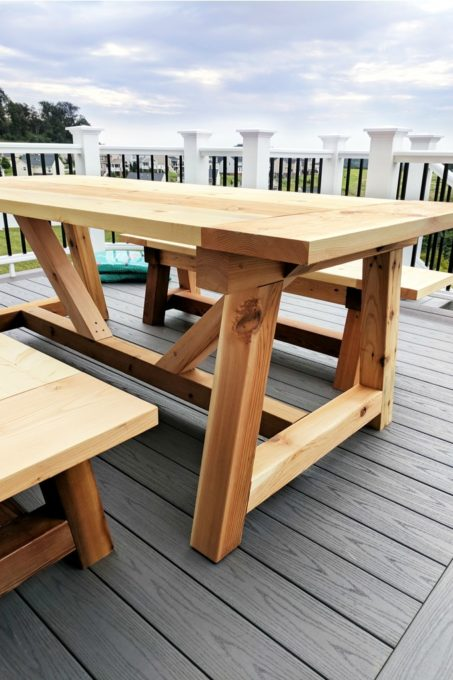 DIY Truss Beam Farmhouse Style Outdoor Table and Benches, DIY- Farmhouse table build, truss beam table, outdoor table, woodworking project, table construction, how to build an outdoor farmhouse table, Ana White plans, Restoration Hardware inspired, knockoff, farmhouse truss table assembled with matching benches, cedar and pine, table and AZEK deck featured