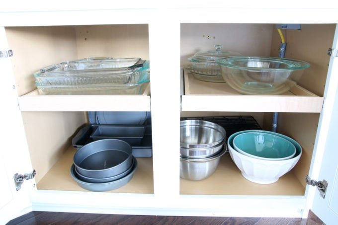 Home Organization- This organized kitchen tour is packed full of ideas to help declutter your kitchen and keep it neat and tidy, coffee station, organized plates, organized pots and pans, bakeware organization, organized paper products, drawer liner, kitchen organization, pantry organization, refrigerator organization, organized kitchen island