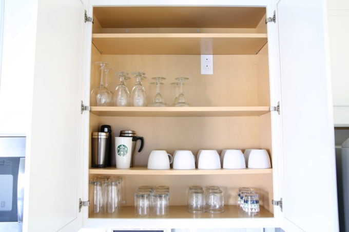 Home Organization- This organized kitchen tour is packed full of ideas to help declutter your kitchen and keep it neat and tidy, coffee station, organized plates, organized pots and pans, bakeware organization, organized paper products, drawer liner, kitchen organization, pantry organization, refrigerator organization, organized kitchen island, coffee station, glasses, cups, and mugs