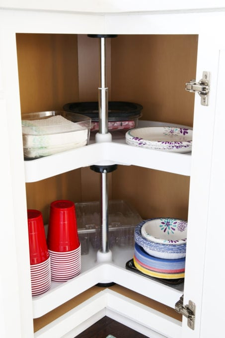 Home Organization- This organized kitchen tour is packed full of ideas to help declutter your kitchen and keep it neat and tidy, coffee station, organized plates, organized pots and pans, bakeware organization, organized paper products, drawer liner, kitchen organization, pantry organization, refrigerator organization, organized kitchen island, lazy susan, paper products organization