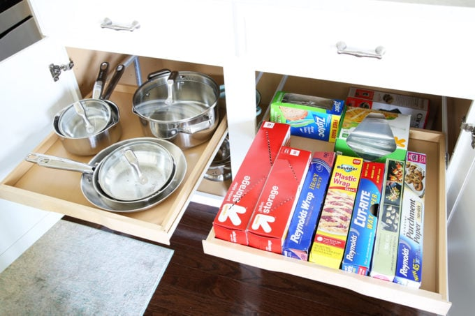 Home Organization- This organized kitchen tour is packed full of ideas to help declutter your kitchen and keep it neat and tidy, coffee station, organized plates, organized pots and pans, bakeware organization, organized paper products, drawer liner, kitchen organization, pantry organization, refrigerator organization, organized kitchen island, kitchen sliding shelves