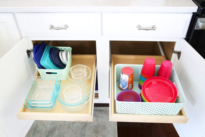 Home Organization- This organized kitchen tour is packed full of ideas to help declutter your kitchen and keep it neat and tidy, coffee station, organized plates, organized pots and pans, bakeware organization, organized paper products, drawer liner, kitchen organization, pantry organization, refrigerator organization, organized kitchen island, organized Tupperware, organized kids dishes