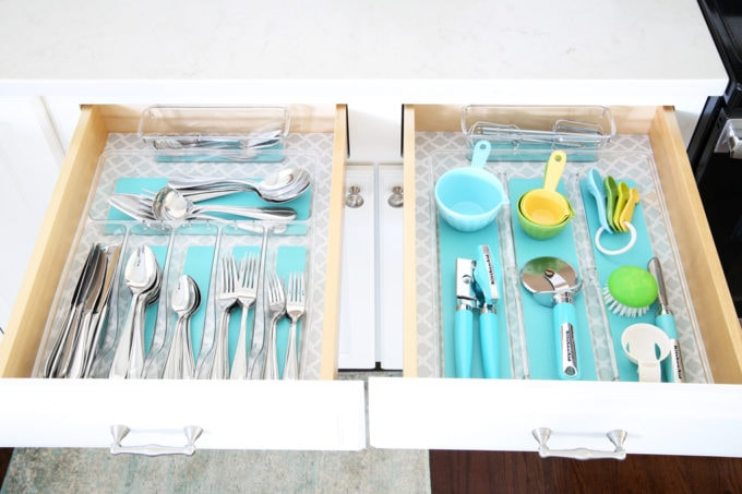 Home Organization- This organized kitchen tour is packed full of ideas to help declutter your kitchen and keep it neat and tidy, coffee station, organized plates, organized pots and pans, bakeware organization, organized paper products, drawer liner, kitchen organization, pantry organization, refrigerator organization, organized kitchen island, silverware drawers and utensils