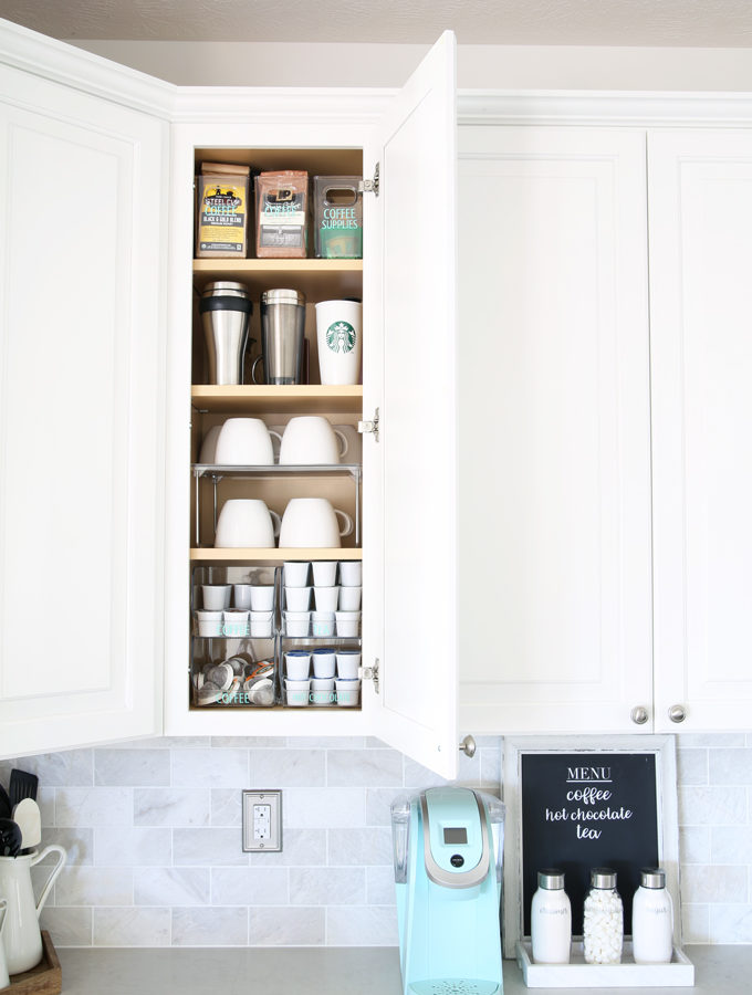 Home Organization- Beautifully Organized Coffee Station, Smoothie Station, kitchen organization, organized kitchen, coffee bar, coffee cabinet, smoothie bar, smoothie cabinet, InterDesign, organizing, acrylic containers, declutter, decluttering, neat and tidy kitchen, keurig, kitchen counter, cabinet open