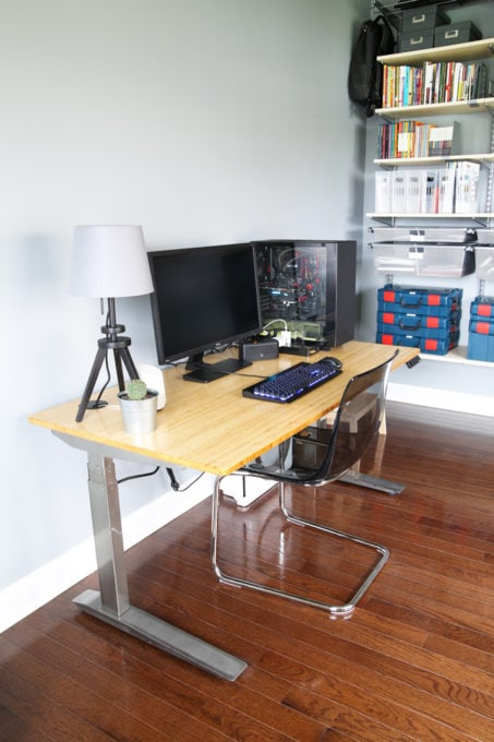 Home Organization- Organized and Masculine Home Office Reveal, man cave, office organization, The Container Store, Elfa, built in shelves, POANG, IKEA, standing desk, window trim, manly office, room makeover, room reveal, Elfa utility grate, office corner, motorized sitting standing desk