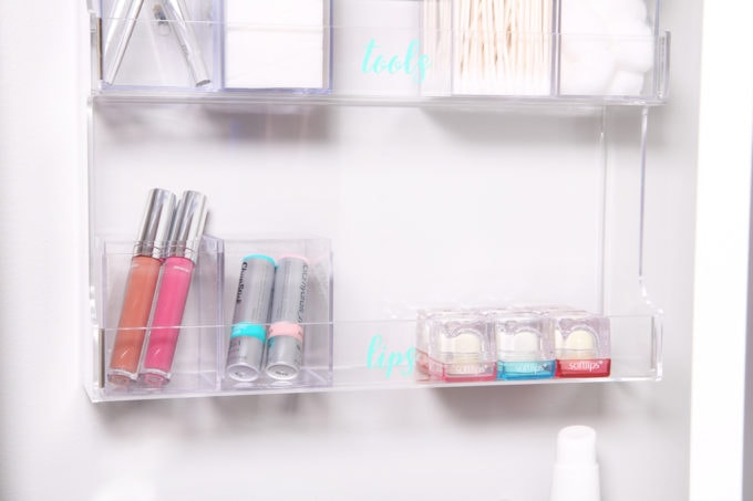 Home Organization- DIY Minimalist Makeup Organization, organizing, organized makeup, beauty organization, decluttering, minimal, simple makeup organization, spice rack, the container store, organization hack, acrylic organizers, makeup placed in spice rack organizer, organized lip gloss and chapstick