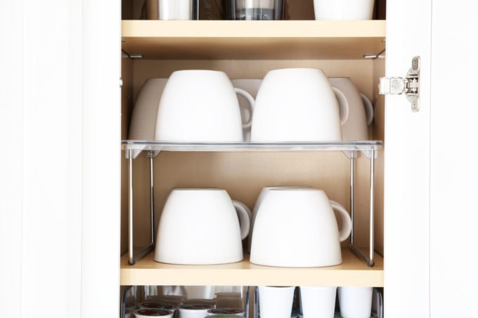 Home Organization- Beautifully Organized Coffee Station, Smoothie Station, kitchen organization, organized kitchen, coffee bar, coffee cabinet, smoothie bar, smoothie cabinet, InterDesign, organizing, acrylic containers, declutter, decluttering, neat and tidy kitchen, mug storage, cabinet riser