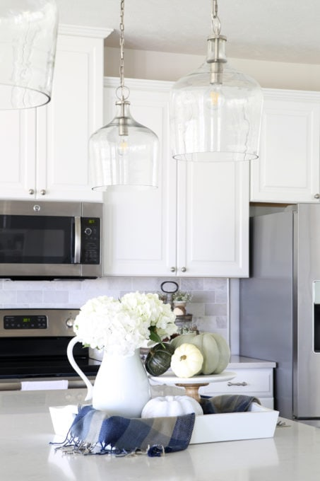 Home- Kitchen island pendant lights, hallway pendant lights, lanterns, changing light fixtures, kitchen lighting, hallway lighting, design mistakes, glass pendant lights, white kitchen, clear glass lighting