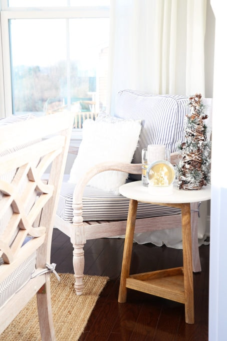 Home- Beautiful neutral Christmas home tour with silver, gold, gray, and white, Holiday Seasonal Simplicity Tour, neutral decor, farmhouse decor, cottage style, morning room, Christmas sunroom, blue ticking striped cushions, marble and wood side table