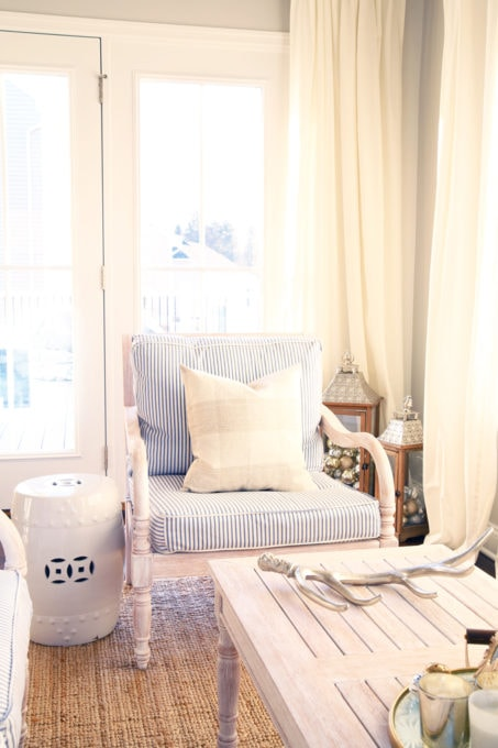 Home- Beautiful neutral Christmas home tour with silver, gold, gray, and white, Holiday Seasonal Simplicity Tour, neutral decor, farmhouse decor, cottage style, morning room, Christmas sunroom, blue ticking striped cushions, garden stool