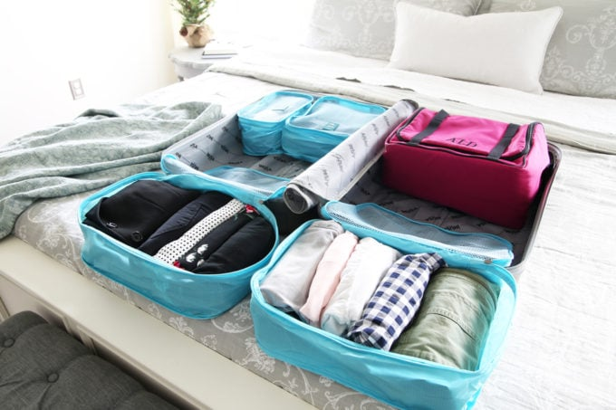 Travel, Home Organization- How to Pack an Organized Suitcase When You Travel, suitcase organization, packing cubes, toiletry bag, trip, flying, traveling, suitcase organization, L.L. Bean Traveler Toiletry Bag, suitcase packed with travel items, packing cubes with filed clothing