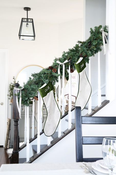 Home- Beautiful neutral Christmas home tour with silver, gold, gray, and white, Holiday Seasonal Simplicity Tour, neutral decor, farmhouse decor, cottage style, Christmas dining room decor, Christmas stockings on stair railing