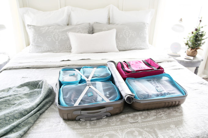 Travel, Home Organization- How to Pack an Organized Suitcase When You Travel, suitcase organization, packing cubes, toiletry bag, trip, flying, traveling, suitcase organization, L.L. Bean Traveler Toiletry Bag, suitcase packed with travel items