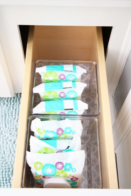 Home Organization- guest bathroom refresh, bathroom organization, organized bathroom vanity, kids bathroom organization, farmhouse bathroom decorating, cottage bathroom decor, white bathroom vanity, InterDesign, Ryan Homes Palermo, cabinet under the sink, baby wipes