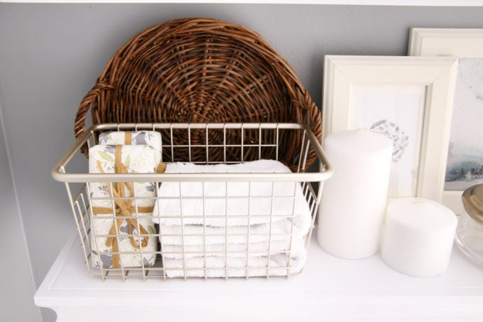 Home Organization- guest bathroom refresh, bathroom organization, organized bathroom vanity, kids bathroom organization, farmhouse bathroom decorating, cottage bathroom decor, white bathroom vanity, InterDesign, Ryan Homes Palermo, styled bathroom floating shelves, wire basket