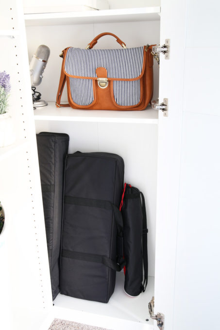 The IKEA PAX system was the perfect way to organize this messy corner of my office. I was able to store so much in the cabinets! | organized home office, office organization, IKEA hack, PAX wardrobe system, decor storage ideas, how to organize gift wrap, organized office supples, camera equipment, storing photography equipment