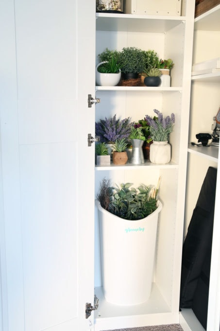 The IKEA PAX system was the perfect way to organize this messy corner of my office. I was able to store so much in the cabinets! | organized home office, office organization, IKEA hack, PAX wardrobe system, decor storage ideas, how to organize gift wrap, organized office supplies, faux greenery storage, faux flowers