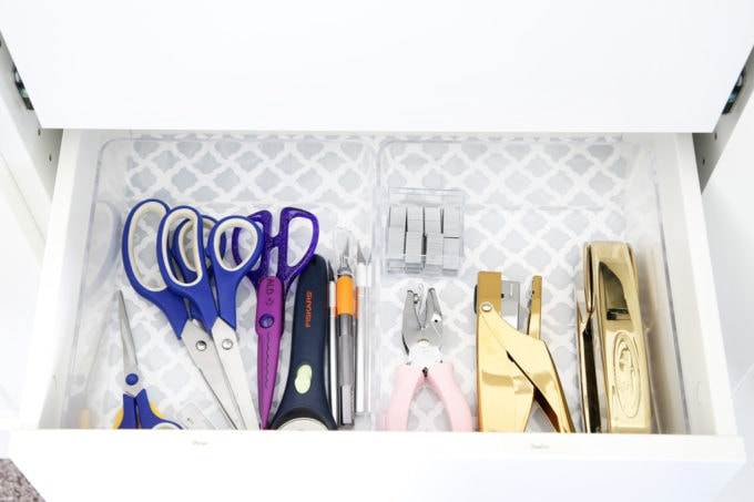 The IKEA PAX system was the perfect way to organize this messy corner of my office. I was able to store so much in the cabinets! | organized home office, office organization, IKEA hack, PAX wardrobe system, decor storage ideas, how to organize gift wrap, organized office supples, scissors, exacto knife, staplers, hole punch
