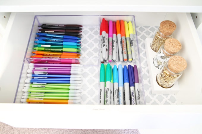 The IKEA PAX system was the perfect way to organize this messy corner of my office. I was able to store so much in the cabinets! | organized home office, office organization, IKEA hack, PAX wardrobe system, decor storage ideas, how to organize gift wrap, organized office supples, writing utensils, organizing by color, Sharpies, pens, pencils