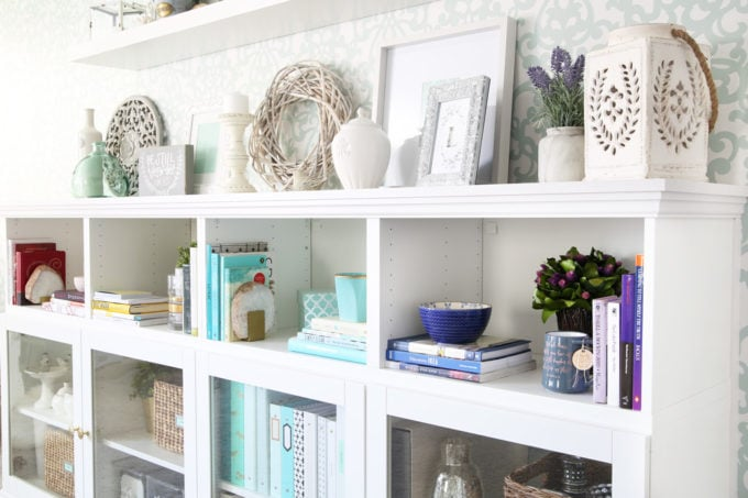 I love this IKEA BESTA hack to make a beautiful storage unit for a home office! And she tells you exactly how to do it too! | IKEA BESTA, IKEA hack, BESTA system, home office, DIY, trim work, office storage, office organization, organized office, shelf styling, bookshelf styling, styled shelves, functional and beautiful, attaching trim pieces to IKEA BESTA, crown molding, top trim pieces, styled bookcase details