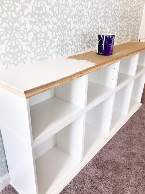 I love this IKEA BESTA hack to make a beautiful storage unit for a home office! And she tells you exactly how to do it too! | IKEA BESTA, IKEA hack, BESTA system, home office, DIY, trim work, office storage, office organization, organized office, shelf styling, bookshelf styling, styled shelves, functional and beautiful, attaching trim pieces to IKEA BESTA, crown molding, top trim pieces, painting