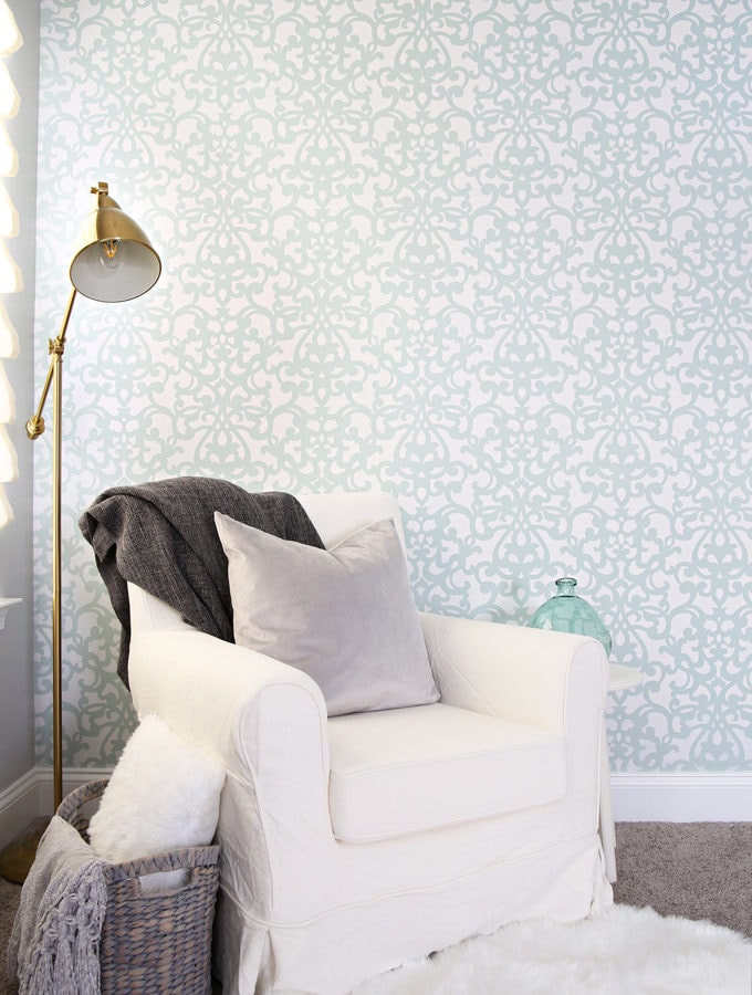 This detailed post is so helpful in teaching how to stencil a wall, allover stenciling! The outcome is absolutely gorgeous! | stenciled wall, stenciling, allover stencil, damask stencil, base color, Sherwin Williams Rainwashed, stenciling in progress, stenciled wall with reading nook, reading corner