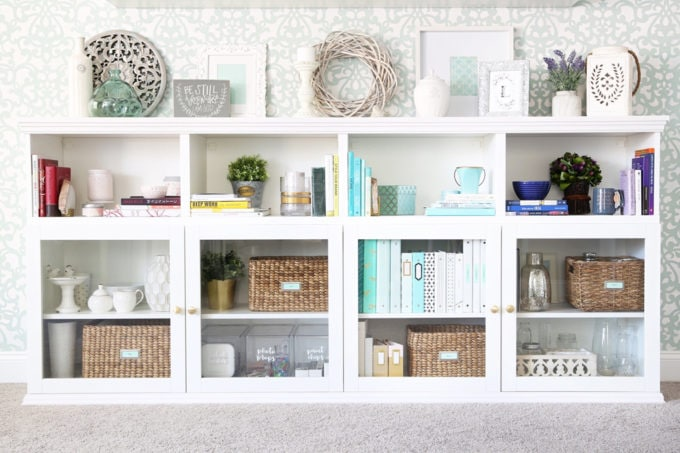 I love this IKEA BESTA hack to make a beautiful storage unit for a home office! And she tells you exactly how to do it too! | IKEA BESTA, IKEA hack, BESTA system, home office, DIY, trim work, office storage, office organization, organized office, shelf styling, bookshelf styling, styled shelves, functional and beautiful, attaching trim pieces to IKEA BESTA, crown molding, top trim pieces, styled bookcase full view