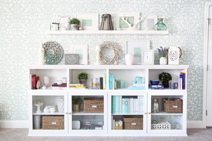 I love this IKEA BESTA hack to make a beautiful storage unit for a home office! And she tells you exactly how to do it too! | IKEA BESTA, IKEA hack, BESTA system, home office, DIY, trim work, office storage, office organization, organized office, shelf styling, bookshelf styling, styled shelves, functional and beautiful, attaching trim pieces to IKEA BESTA, crown molding, top trim pieces, styled bookcase